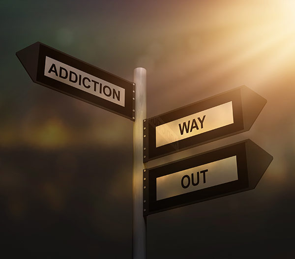 "signs display words ""addiction"" and ""way out"""
