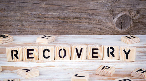 "blocks spell out the word ""recovery"""