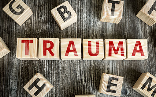 "blocks spell out the word ""trauma"""