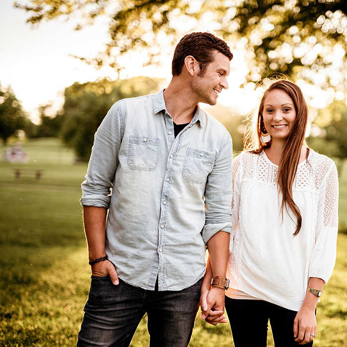 young couple smiling in a park